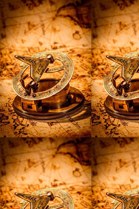 Tapeta Pixerstick Vintage kompas leží na staré mapě světa. - Témata