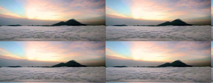 Tapeta Pixerstick Východ slunce nad mraky s výhledem na hory sopky - Témata