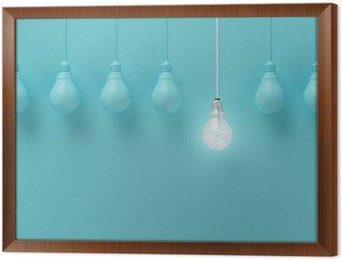 Tavla i Ram Hängande glödlampor med glödande en annan idé på ljusblå bakgrund, Minimal begrepp idé, platt låg, topp