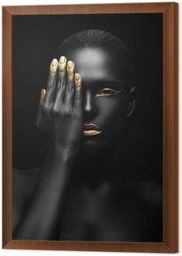 Tavla i Ram Mörkhyad kvinna med gyllene make-up.