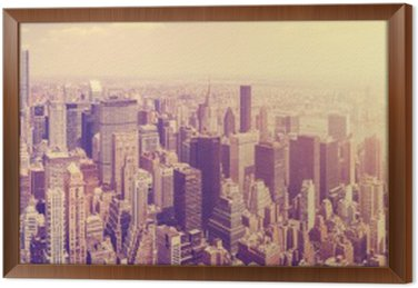 Tavla i Ram Vintage tonas Manhattans skyline i solnedgången, NYC, USA.