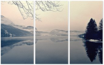 Triptych Snowy winter landscape on the lake in black and white. Monochrome image filtered in retro, vintage style with soft focus, red filter and some noise; nostalgic concept of winter. Lake Bohinj, Slovenia.