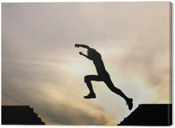 Tuval Baskı Günbatımı karşı çocuğu atlama siluet