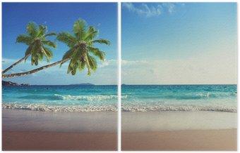 Tweeluik Zonsondergang op het strand van de Seychellen