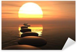 Vinilo Pixerstick Camino zen de piedras en la puesta del sol