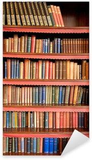 Vinilo Pixerstick Estantería vieja con hileras de libros en la biblioteca antigua