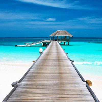 Pixerstick para Todas las Superficies Hermosa playa con bungalows en el agua