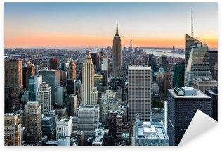 Vinilo Pixerstick Horizonte de Nueva York al atardecer
