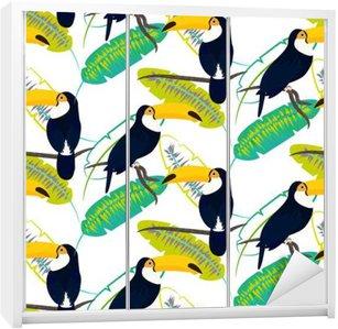 Vinilo para Armario Toco tucán en hojas de plátano vector patrón sin fisuras en el fondo blanco. hoja de la selva tropical y aves exóticas sentado en la rama.