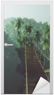 Vinilo para Puerta Rope bridge in misty jungle with palms. Backlit.