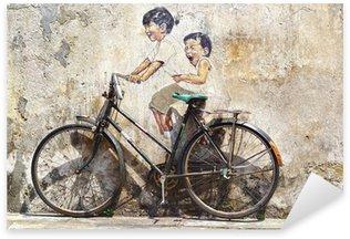 """Vinilo Pixerstick """"Pequeños niños en una bicicleta"""" Mural."""