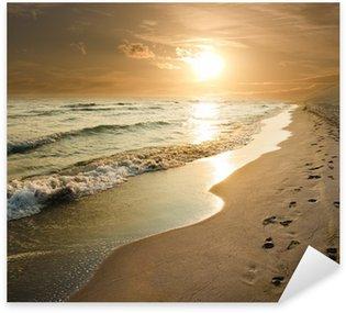 Pixerstick para Todas las Superficies Puesta del sol de oro en la orilla del mar