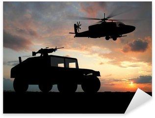 Vinilo Pixerstick Silueta de la puesta del sol sobre camión con helicóptero.