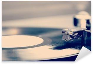 Pixerstick para Todas las Superficies Spinning disco de vinilo. Motion blur la imagen. Vintage tonificado.