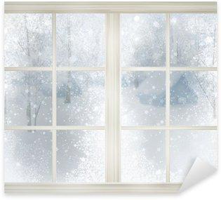 Pixerstick para Todas las Superficies Ventana con vista de invierno de fondo cubierto de nieve.