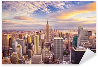 Vinilo Pixerstick Vista del atardecer de la ciudad de Nueva York con vistas a Manhattan