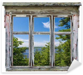 Vinilo Pixerstick Vista panorámica vista a través de un marco de ventana de edad