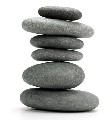 6 pebbles stacked - image isolated over white background