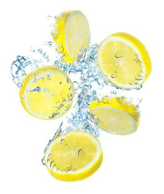 Lemons and water splash. Organic food