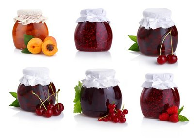 Set of jars with berry jam isolated on white