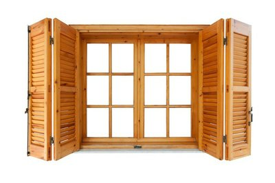 Wooden window with shutters isolated exterior side