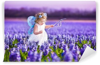 Adorable toddler girl in fairy costume in a flower field Wall Mural - Vinyl