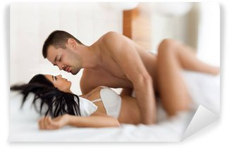 amorous couple making love in bed Wall Mural - Vinyl
