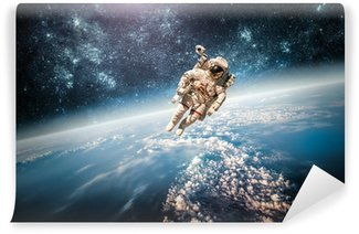 Astronaut outer spac Elements of this image furnished by NASA. Wall Mural - Vinyl