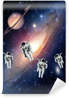Astronauts spaceman outer space solar system saturn planet universe. Elements of this image furnished by NASA. Wall Mural - Vinyl
