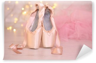 Vinyl Wall Mural Ballet pointe shoes on floor on bokeh background