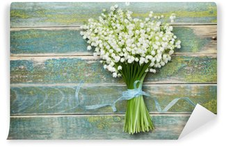 Beautiful bouquet of flowers lily of the valley on vintage wooden table from above, rustic background Wall Mural - Vinyl