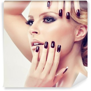Wall Mural - Vinyl Blonde model in burgundy manicure and stylish hairstyle