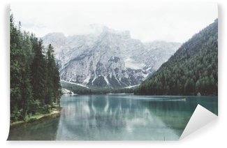 Braies lake with green water and mountains with trees Wall Mural - Vinyl
