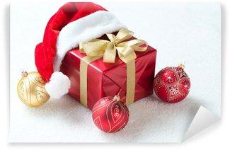 Wall Mural - Vinyl Christmas gift with Santa hat and Christmas balls, studio shot