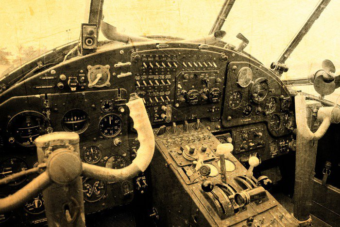 Cockpit of an old biplane vinyl wall mural pixers we for Cockpit wall mural