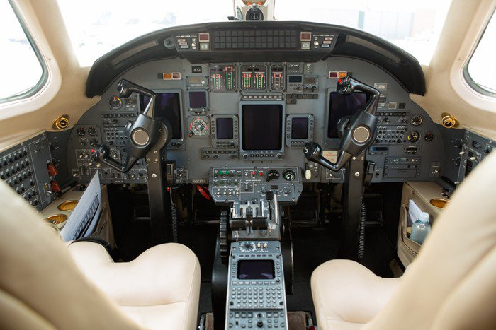 Cockpit of private business jet vinyl wall mural pixers for Cockpit wall mural