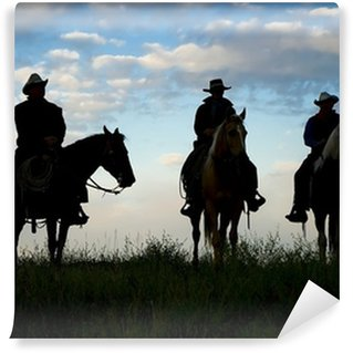 Cowboys on horseback at first light. Silhouettes Wall Mural - Vinyl
