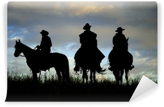 Wall Mural - Vinyl Cowboys on horseback on a Montana ridge at dawn