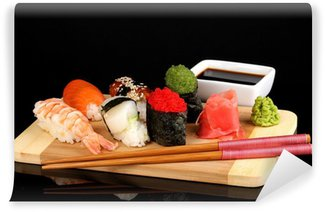 Wall Mural - Vinyl delicious sushi served on wooden board isolated on black