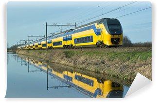 Wall Mural - Vinyl Dutch train en route along canal