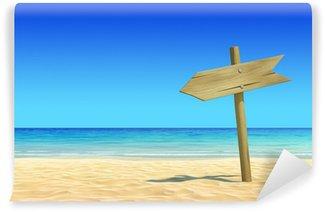 Empty wooden signpost on idyllic tropical sand beach