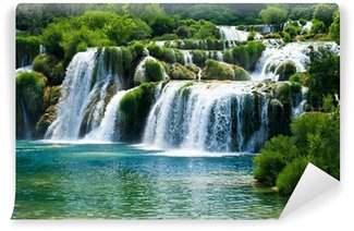 Fairytale waterfall surrounded by greenery Vinyl Wall Mural