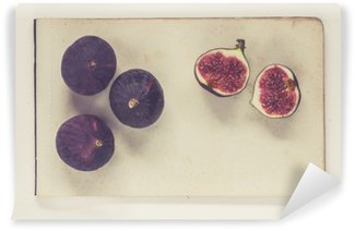 figs lying on sheets of vintage paper - natural history book style