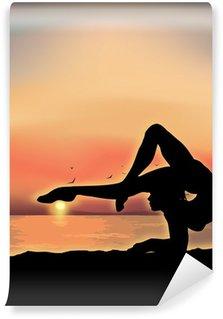 Gymnast exercising near the sea