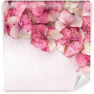Hydrangea flower petals on fabric background