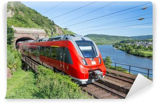 Wall Mural - Vinyl Intercity train leaving a tunnel near the river Moselle in Germa