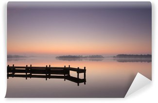 Vinyl Wall Mural Jetty at a lake during a tranquil, foggy dawn.