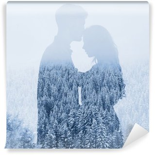 love in winter, silhouette of couple on forest background, double exposure