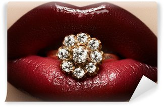 Macro lips cherry make-up with wedding gold diamond ring