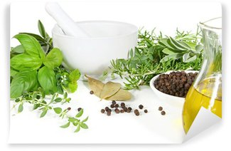 Mortar and pestle with fresh herbs and spices.
